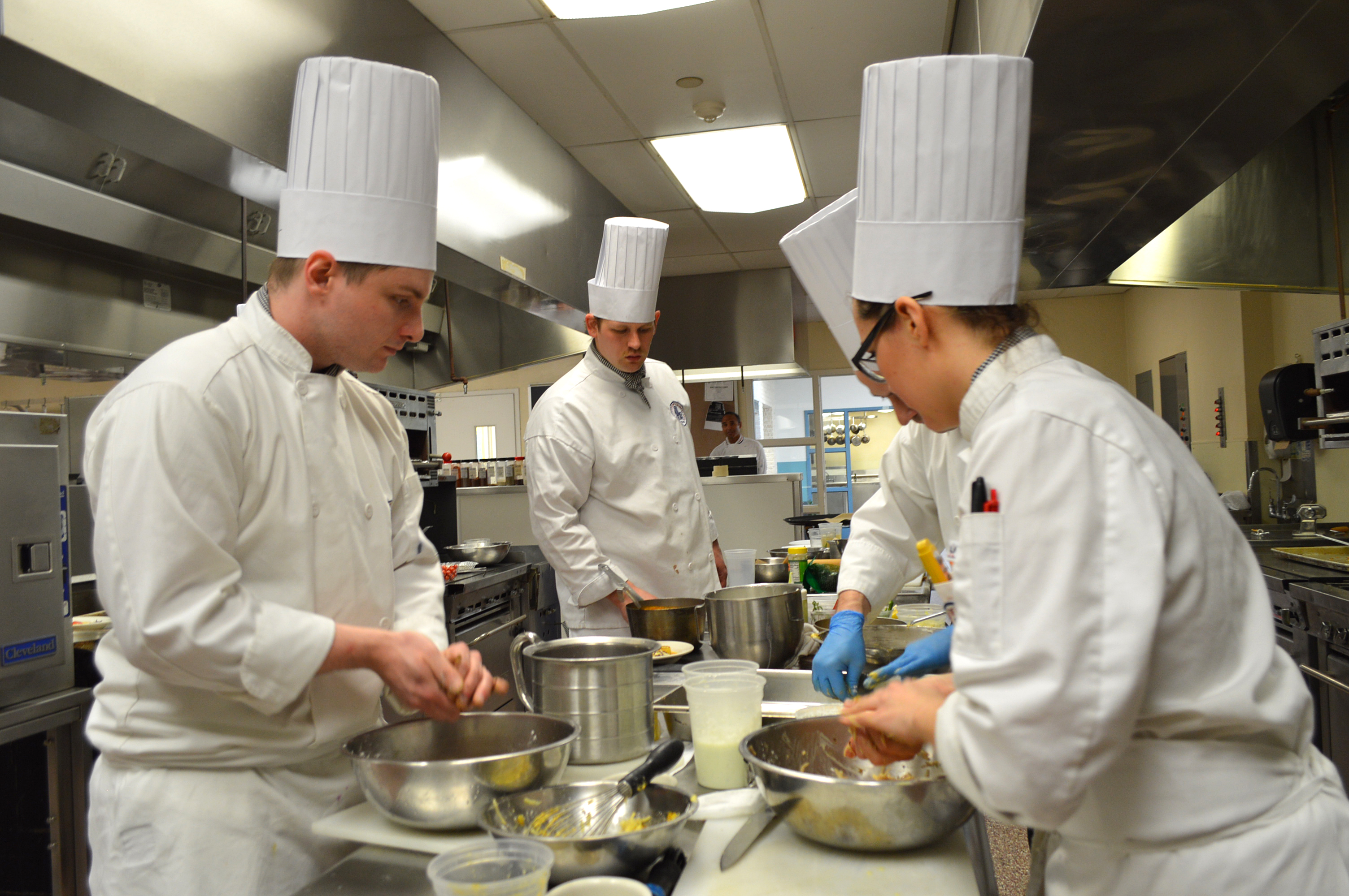 Culinary students in the kitchen preparing food