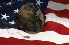 American flag and soldier's helmet