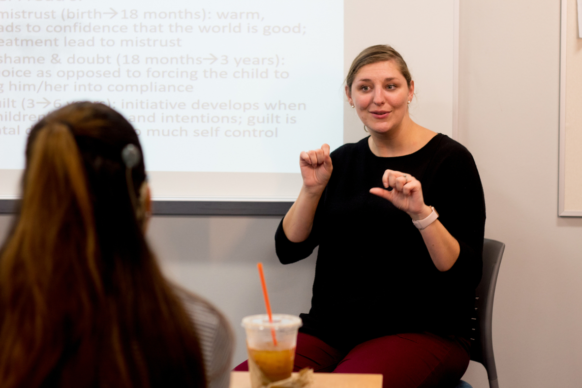 Teacher teaching sign language to student