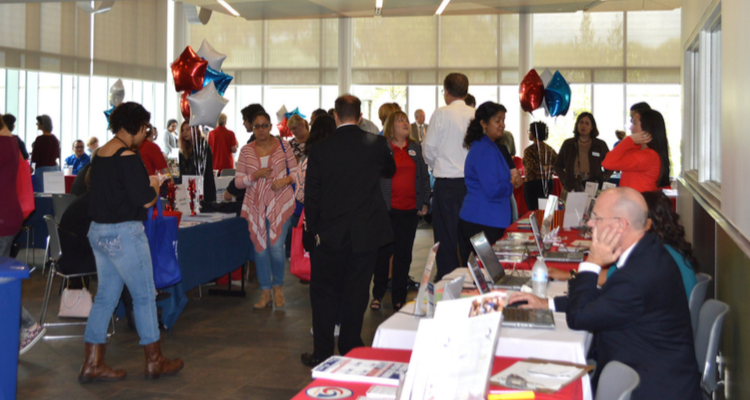 members of the public attend a resource fair available at all three campus locations